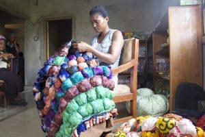 woman-making-ball-pillow
