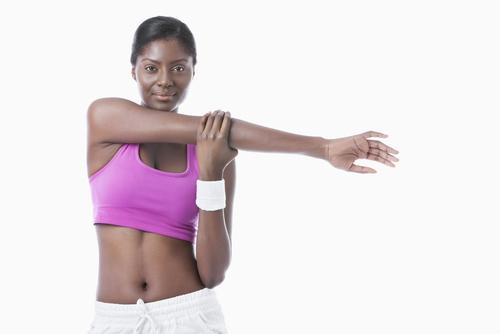 AA woman in sports bra